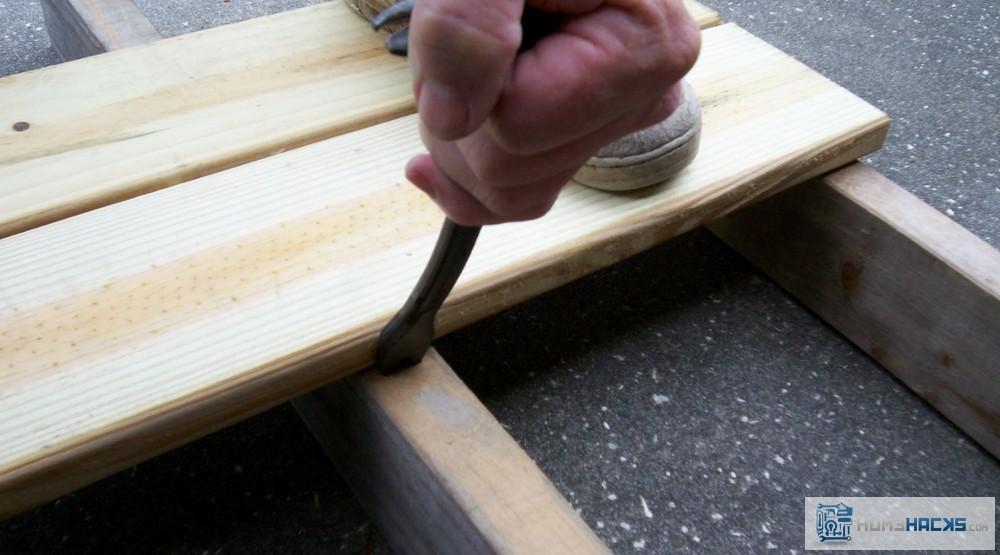 how to fix warped deck boards