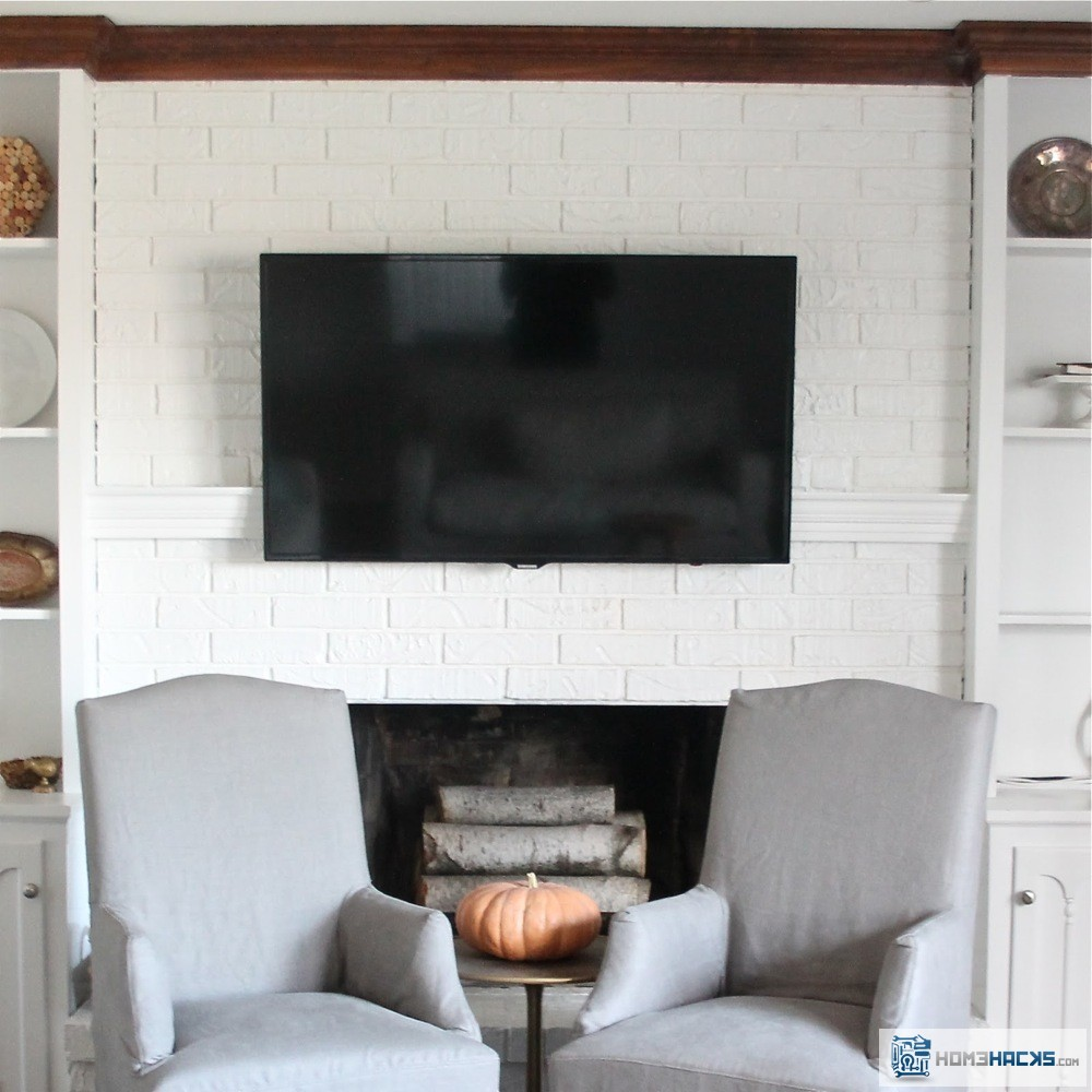 How to hide tv wires over a fireplace homehacks for How to hide electrical cords on wall